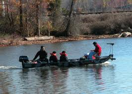Photo of boat of bass fishermen.